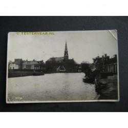 Warga 1931 - gezicht op kerk vanaf het water